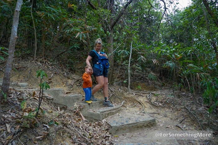 woman hiking with baby and toddler
