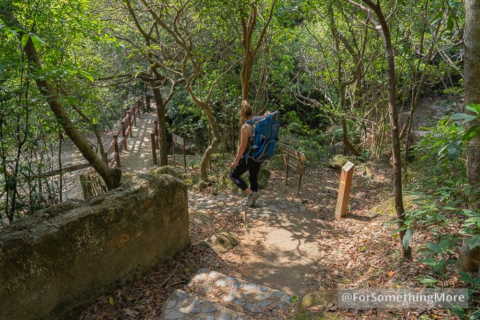 woman hiking in Hong Kong with baby in backpack