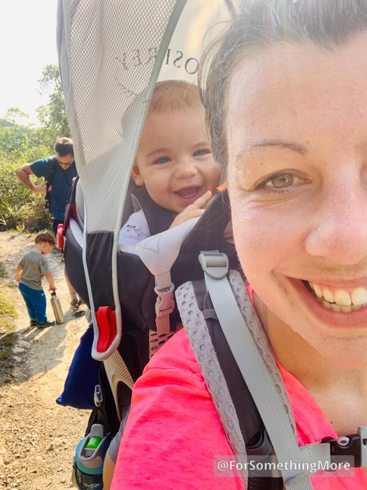 woman hiking with baby in backpack
