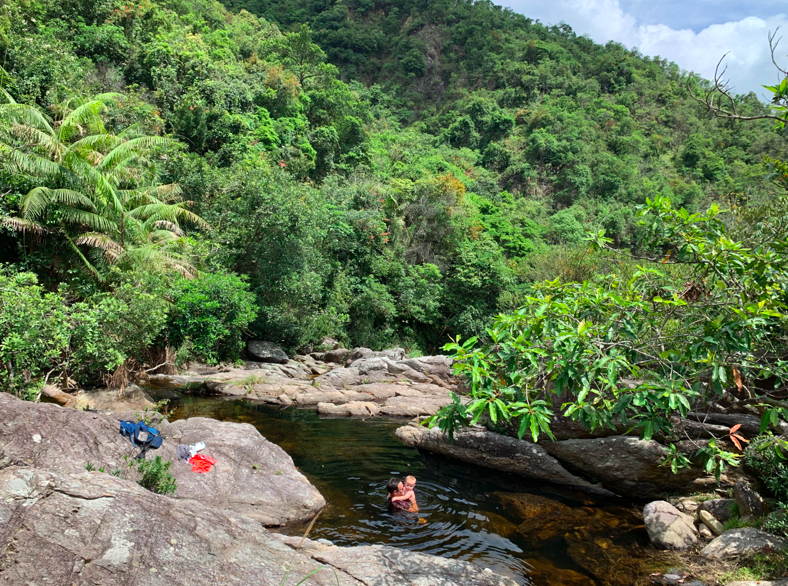 man swimming with baby at Ping Nam Stream