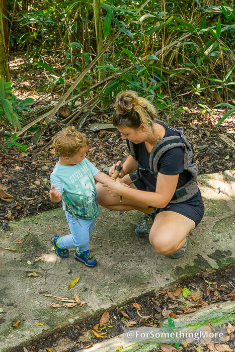 woman putting DEET Free Insect Repellent And After Bite Stick on a boy